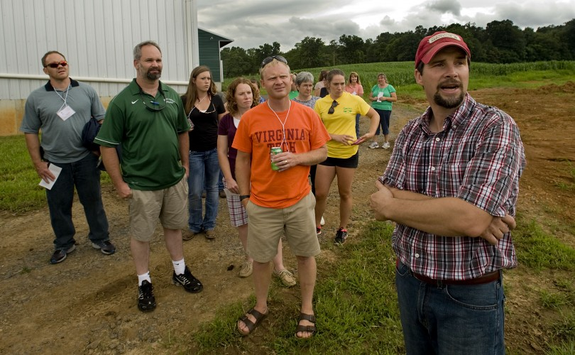 Wade Hawkins, owner of Pleasantdale Farm, leads a group of agriculture educators on his farm west of Woodstock on Wednesday. Rich Cooley/Daily